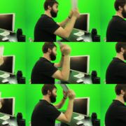 Beard-Man-Beats-the-Screen-with-the-Keyboard-Green-Screen-Footage Green Screen Stock