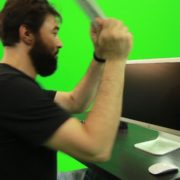 Beard-Man-Beats-the-Screen-with-the-Keyboard-Green-Screen-Footage_001 Green Screen Stock
