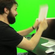 Beard-Man-Beats-the-Screen-with-the-Keyboard-Green-Screen-Footage_004 Green Screen Stock