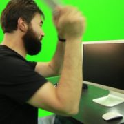 Beard-Man-Beats-the-Screen-with-the-Keyboard-Green-Screen-Footage_005 Green Screen Stock