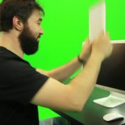Beard-Man-Beats-the-Screen-with-the-Keyboard-Green-Screen-Footage_006 Green Screen Stock