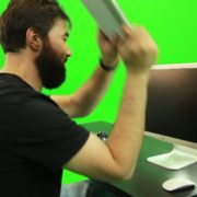 Beard-Man-Beats-the-Screen-with-the-Keyboard-Green-Screen-Footage_008 Green Screen Stock