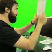 Beard-Man-Beats-the-Screen-with-the-Keyboard-Green-Screen-Footage_009 Green Screen Stock