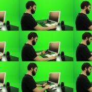 Beard-Man-Searching-in-the-Phone-Green-Screen-Footage Green Screen Stock