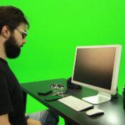 Beard-Man-Searching-in-the-Phone-Green-Screen-Footage_001 Green Screen Stock