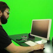 Beard-Man-Searching-in-the-Phone-Green-Screen-Footage_002 Green Screen Stock