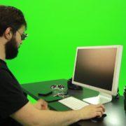 Beard-Man-Searching-in-the-Phone-Green-Screen-Footage_004 Green Screen Stock