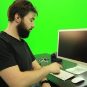 vj video background Beard-Man-Types-the-Code-for-Computer-Explosion-Green-Screen-Footage_003