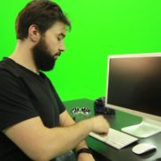 Beard-Man-Types-the-Code-for-Computer-Explosion-Green-Screen-Footage_004 Green Screen Stock