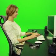 Laughing-Woman-Working-on-the-Computer-Green-Screen-Footage_001 Green Screen Stock