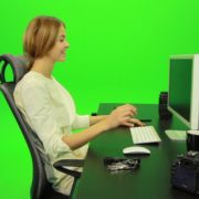 vj video background Laughing-Woman-Working-on-the-Computer-Green-Screen-Footage_003