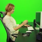 Laughing-Woman-Working-on-the-Computer-Green-Screen-Footage_005 Green Screen Stock