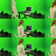 Woman-Sits-Down-and-Works-on-the-Computer-Green-Screen-Footage Green Screen Stock