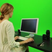 Woman-Sits-Down-and-Works-on-the-Computer-Green-Screen-Footage_006 Green Screen Stock