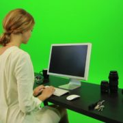 Woman-Sits-Down-and-Works-on-the-Computer-Green-Screen-Footage_007 Green Screen Stock