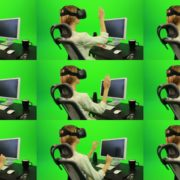 Woman-Working-on-the-Computer-in-Virtual-Reality-Green-Screen-Footage Green Screen Stock