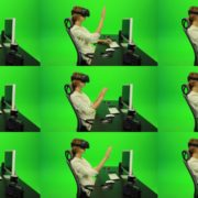 Woman-Working-on-the-Computer-in-Virtual-Reality-Green-Screen-Footage1 Green Screen Stock