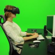 Woman-Working-on-the-Computer-in-Virtual-Reality-Green-Screen-Footage1_001 Green Screen Stock