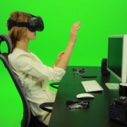 Woman-Working-on-the-Computer-in-Virtual-Reality-Green-Screen-Footage1_007 Green Screen Stock