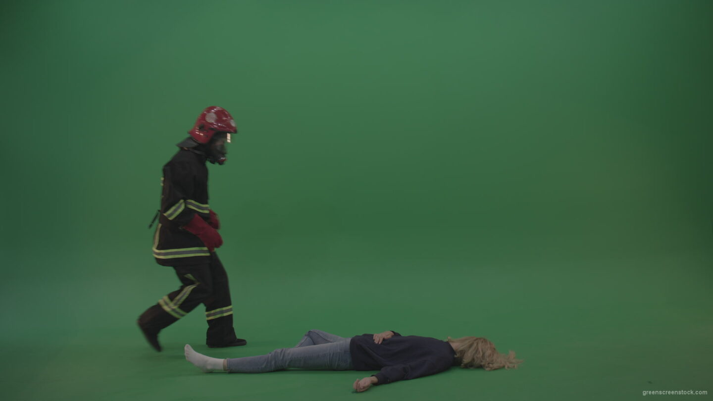 vj video background Brave_Fireman_Runs_To_Unconscious_Young_Victim_Girl_Slightly_Wakes_Her_Up_Takes_On_Strong_Hands_And_Carries_Towards_Safety_On_Green_Screen_Wall_Background_003