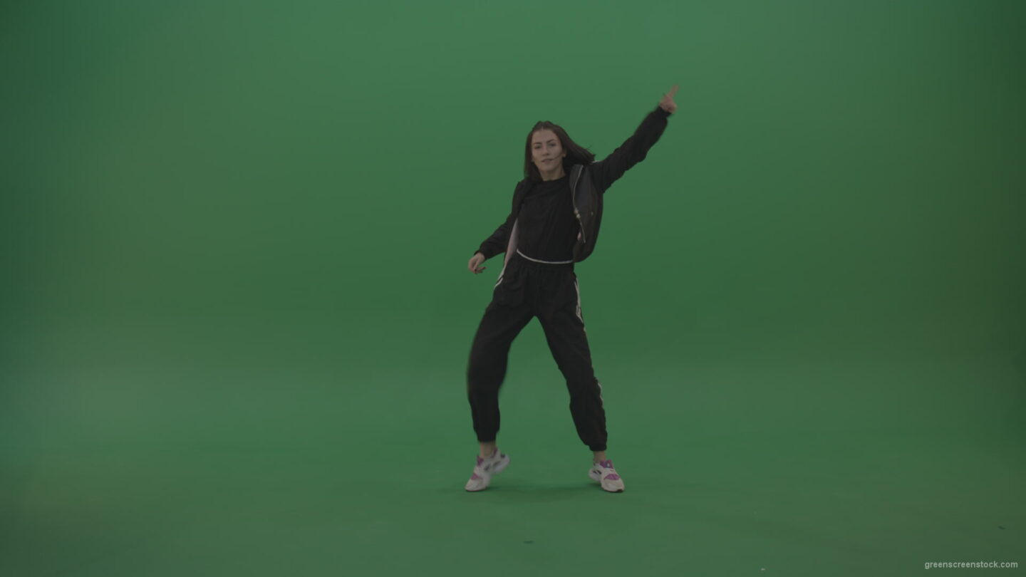 vj video background Incredible_Dance_Hip_Hop_Moves_From_Young_Brunette_Female_Wearing_Black_Sweat_Suite_And_White_Trainers_On_Green_Screen_Wall_Background_003