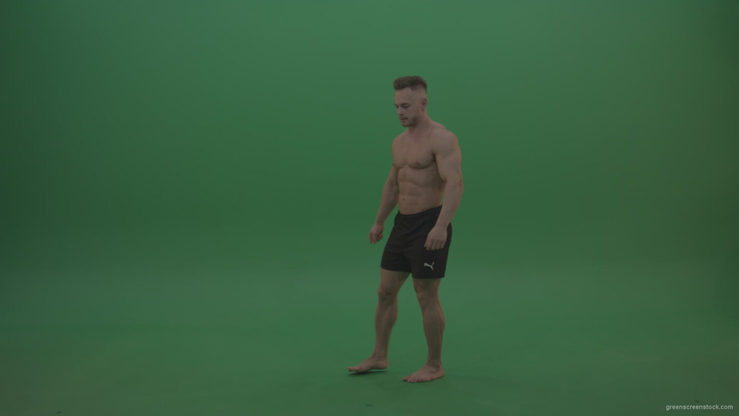 vj video background Young_Athletic_Bodybuilder_Demonstrating_Front_Double_Biceps_And_Lateral_Spread_Positions_On_Green_Screen_Wall_Background_003