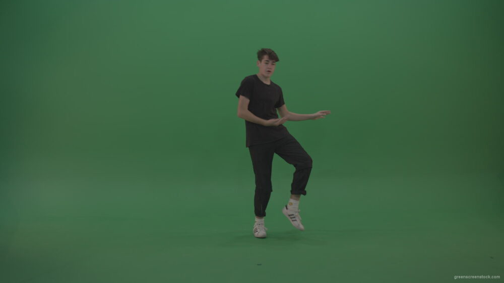 vj video background Young_Brunette_Boy_Showing_Awesome_Hip_Hop_Dance_Technical_Skills_With_Robot_Tought_Moves_On_Green_Screen_Chroma_Key_Background_003
