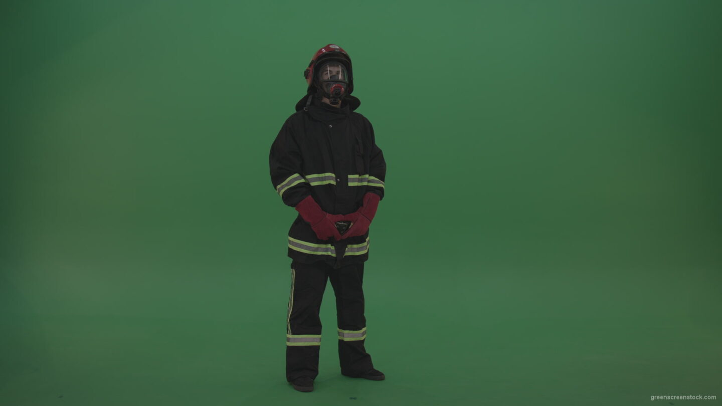 vj video background Young_Firefighter_Wearing_Full_FIreman_Working_Kit_Looking_Around_To_Fing_Some_Fire_Arson_Problems_On_Green_Screen_Wall_Background_003