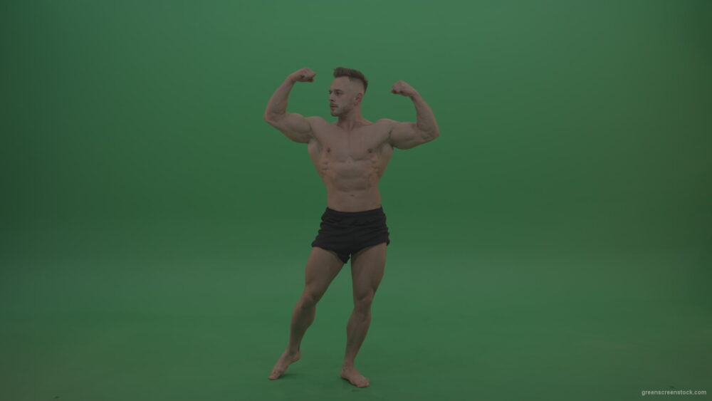 vj video background Young_Sportsman_Showing_Front_Double_Biceps_And_Thigh_Muscles_Bodybuilding_Positions_On_Gren_Screen_Wall_Background_003
