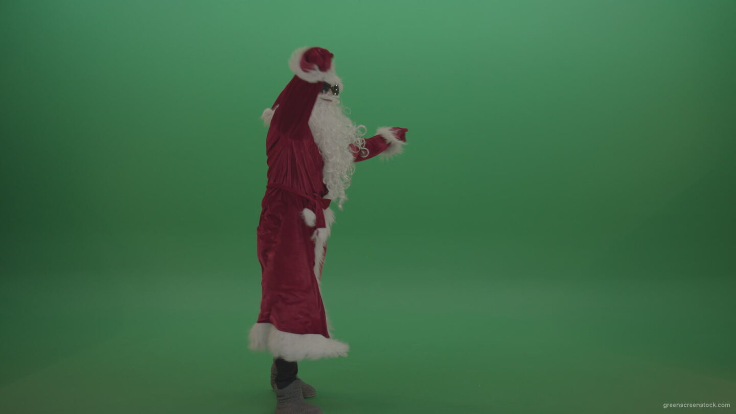 vj video background Santa-in-black-glasses-shows-his-dance-skills-over-chromakey-background_003