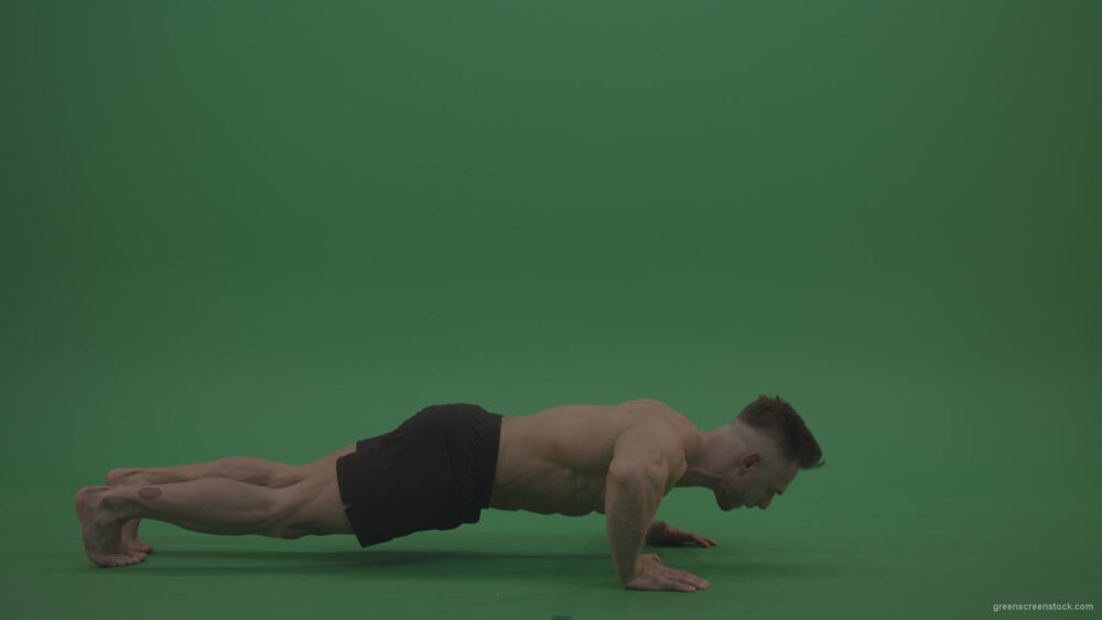 vj video background Young_Bodybuilder_Starts_Working_Out_From_Crouching_Terminator_Position_Does_Pull_Ups_Turns_Back_To_The_Start_Position_On_Green_Screen_Wall_Background_003