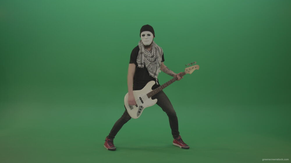 vj video background Bass-man-in-white-mask-play-guitar-on-green-screen_003