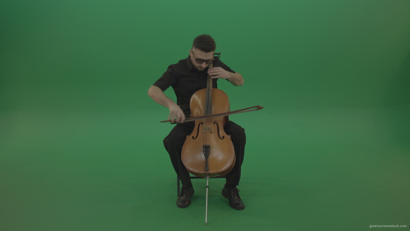 vj video background Man-in-black-playing-fast-violoncello-cello-strings-music-instrument-isolated-on-green-screen_003