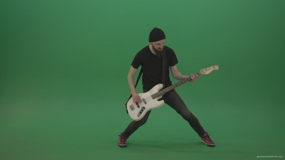 vj video background Young-man-with-beard-in-black-shirt-play-white-bass-guitar-on-green-screen_003