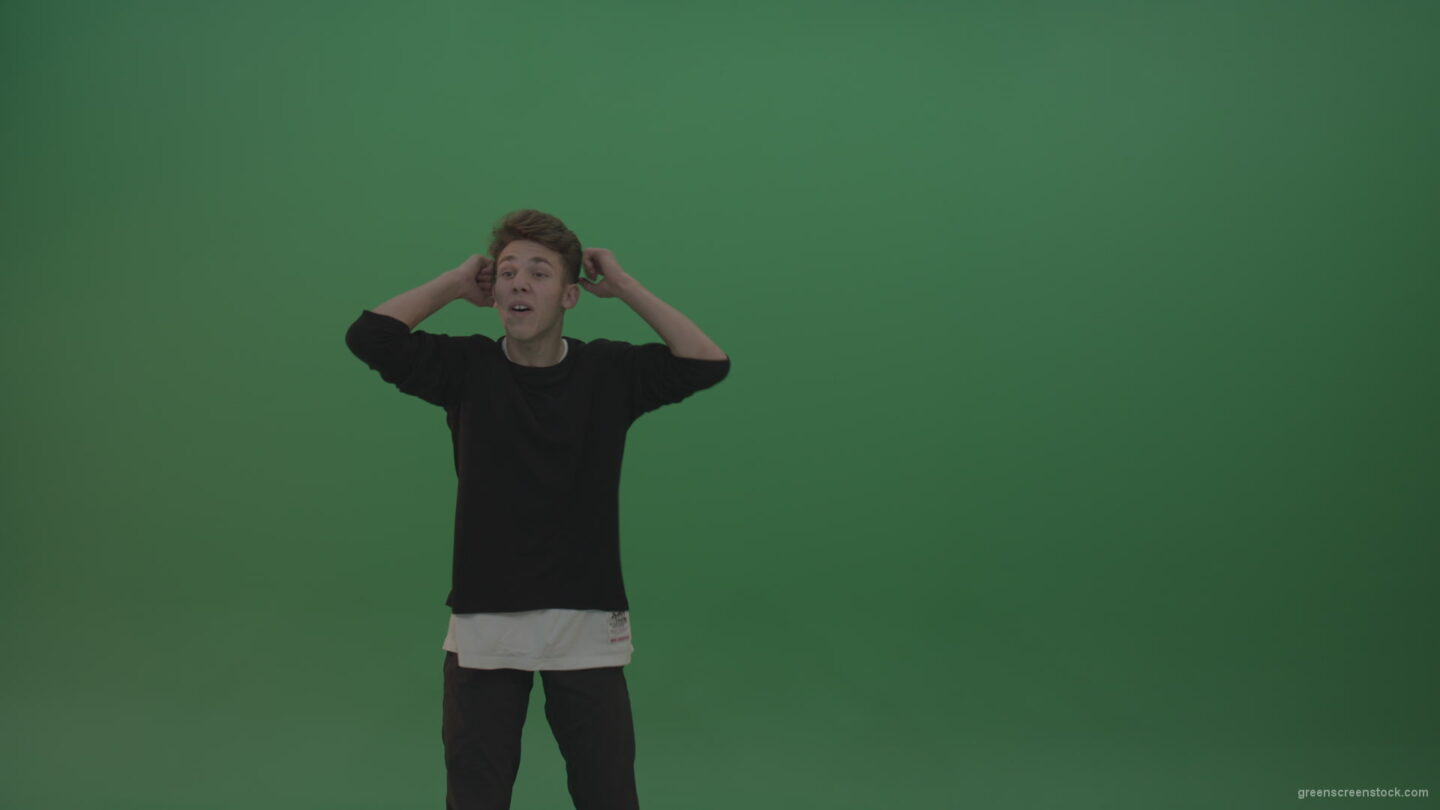 vj video background Boy-in-black-wear-displays-expression-as-he-whistles-over-chromakey-background_003