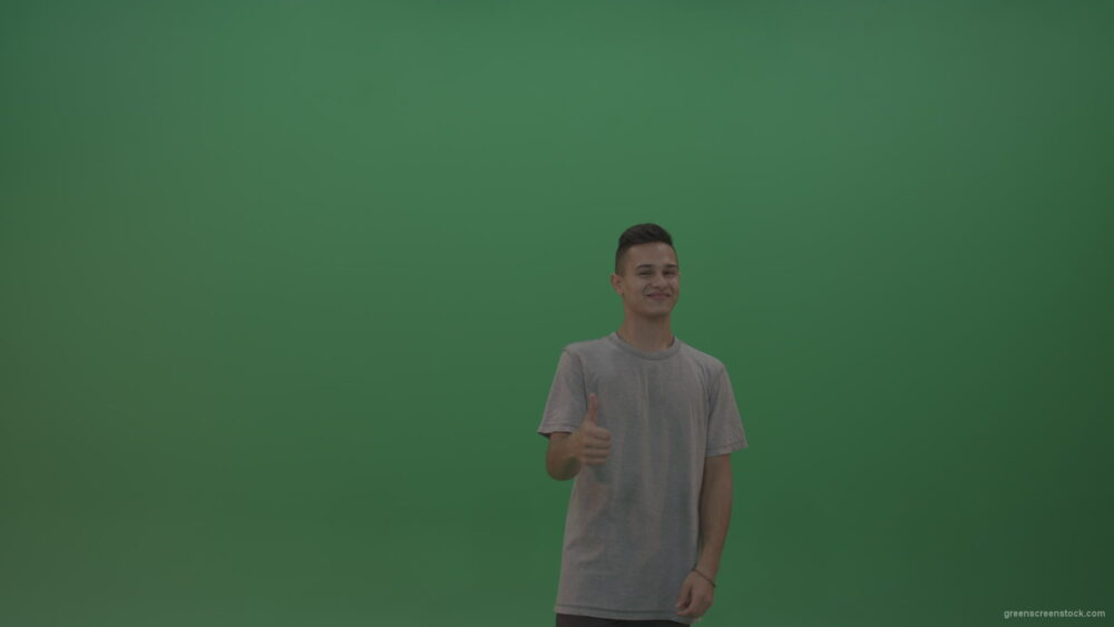 vj video background Boy-in-grey-wear-expresses-approval-by-giving-thumbs-up-over-green-screen-background_003