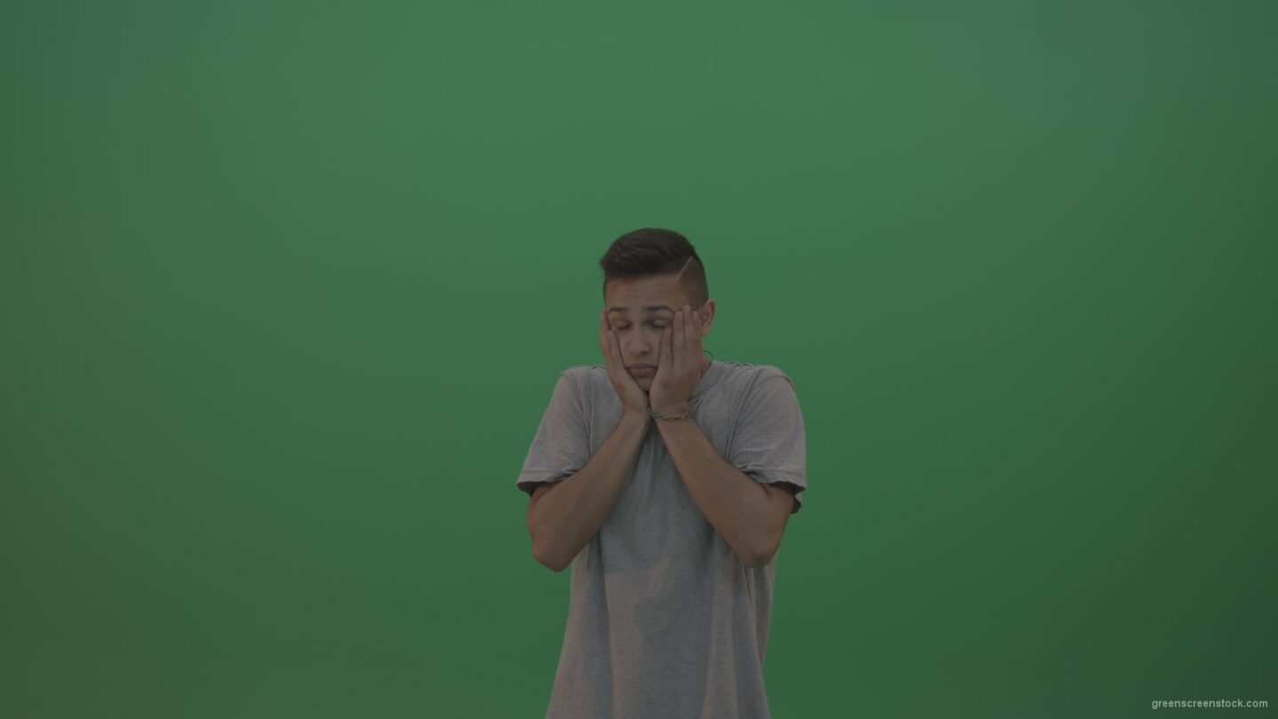 vj video background Boy-in-grey-wear-expresses-disappointment-over-green-screen-background_003