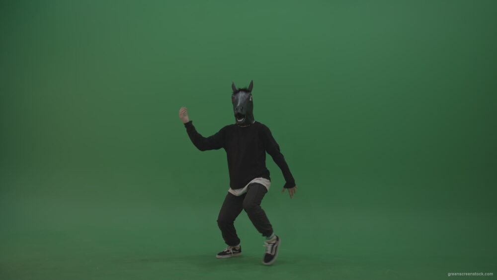 vj video background Boy-in-horse-head-costume-dances-over-green-screen-background_003