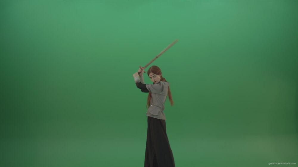 vj video background Fighting-girl-in-silver-armor-swinging-with-the-sword-aiming-at-one-goal-on-chromakey_003