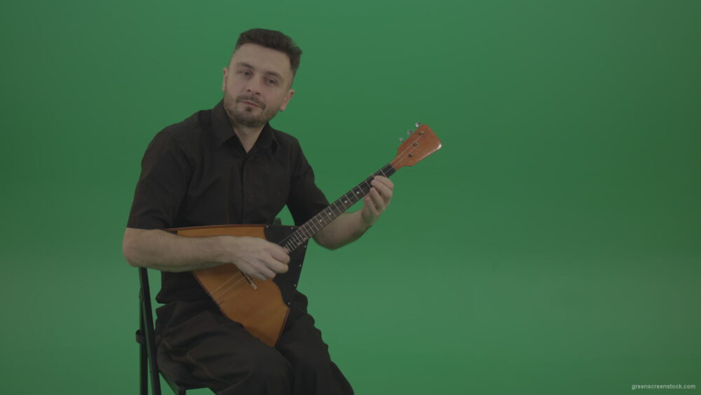vj video background Funny-Balalaika-music-player-in-black-wear-playing-in-wedding-isolated-on-green-screen-background_003