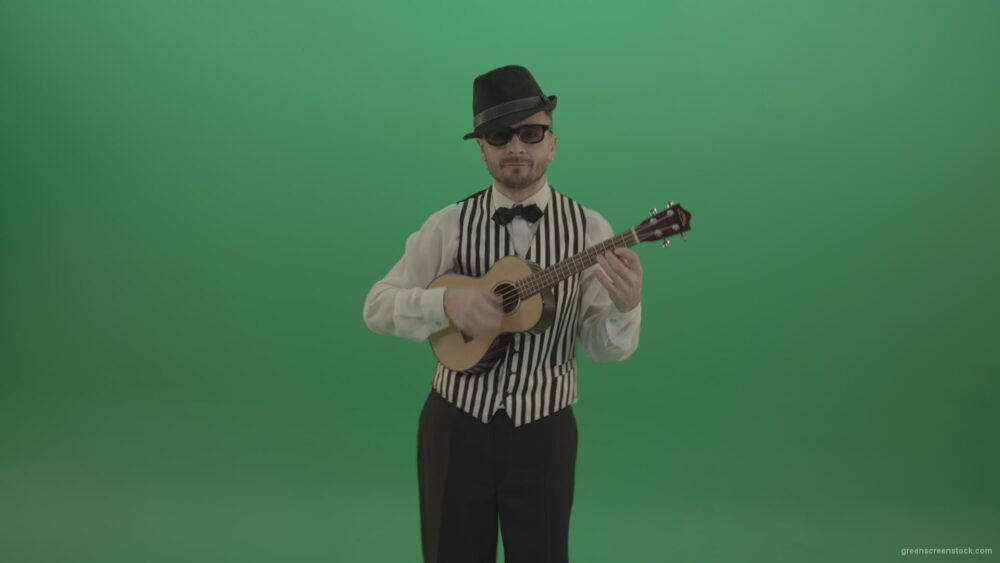 vj video background Funny-guitar-player-with-small-classic-guitar-on-chromakey-green-screen_003