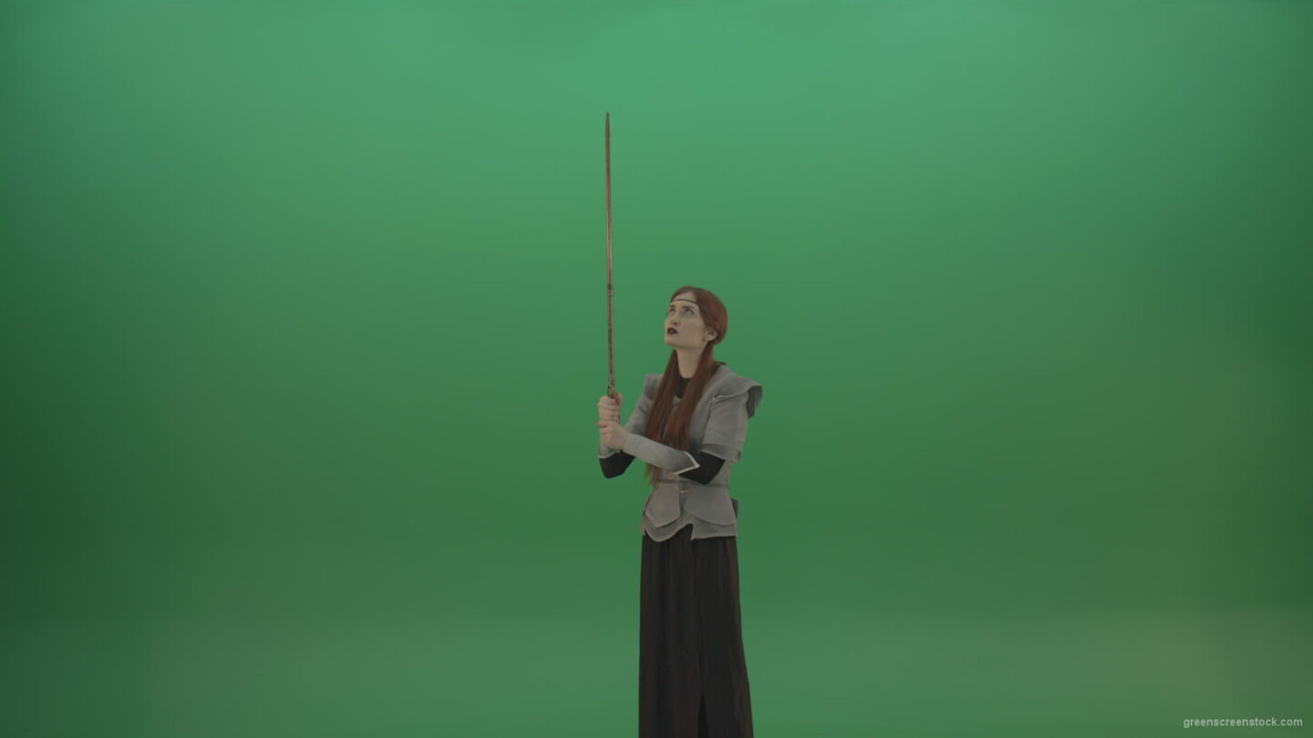 vj video background Girl-shouts-her-foes-on-an-offensive-raising-a-sword-up-on-a-green-background_003