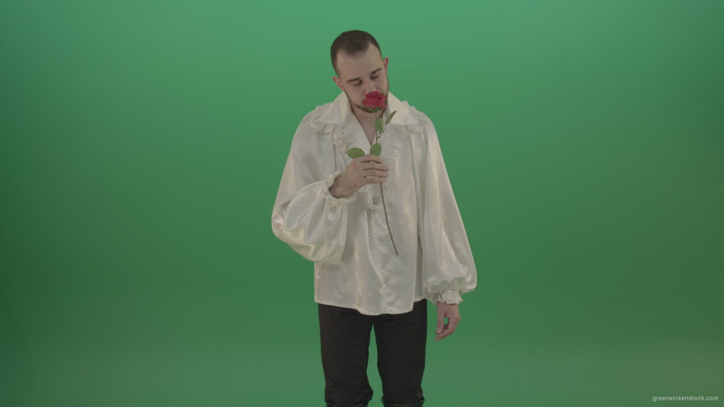 vj video background Glancing-at-the-red-flower-the-guy-gives-love-rose-to-camera-isolated-on-green-screen_003