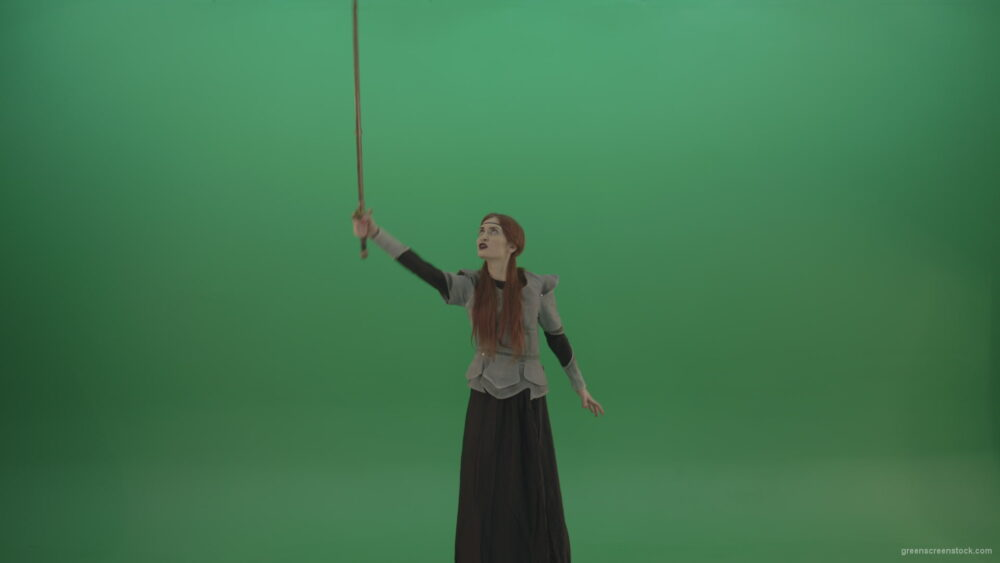 vj video background Great-sword-in-the-hands-of-a-mighty-warrior-girl-lifted-up-one-hand-on-a-green-background_003