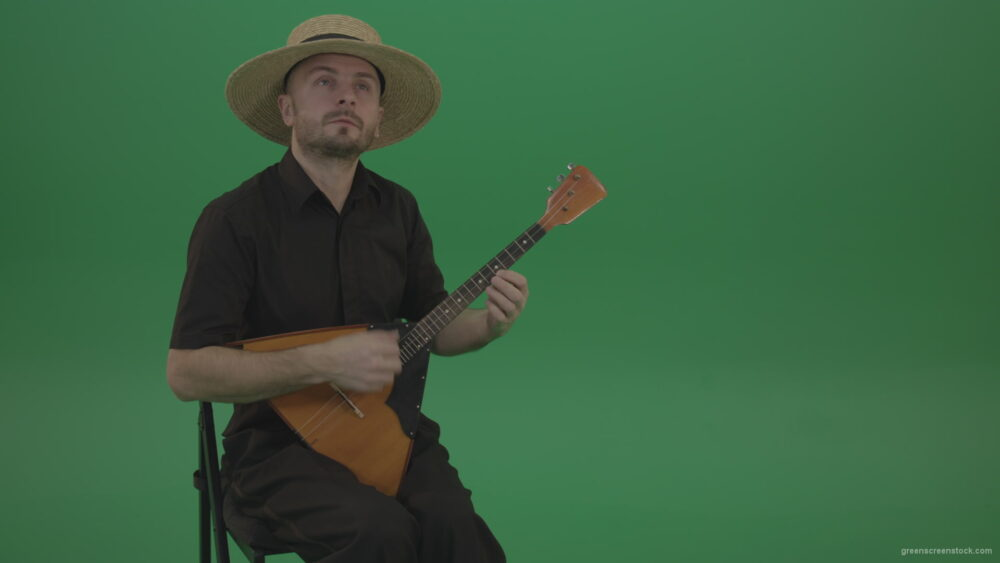 vj video background Man-from-village-play-Balalaika-music-instrument-isolated-on-green-screen_003