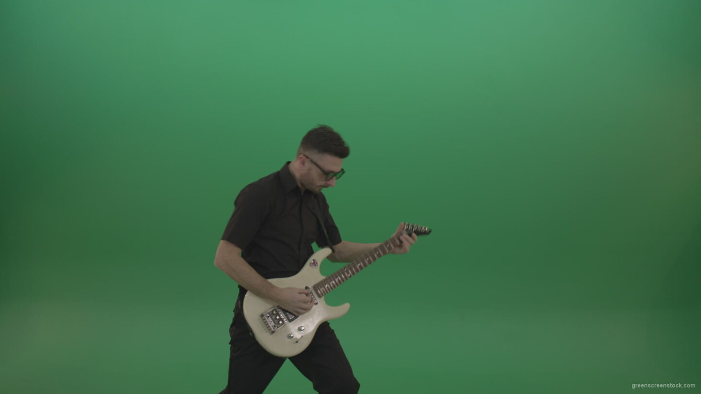 Man-in-black-costume-virtuoso-play-white-electro-rythm-guitar-isolated-on-green-screen_006 Green Screen Stock