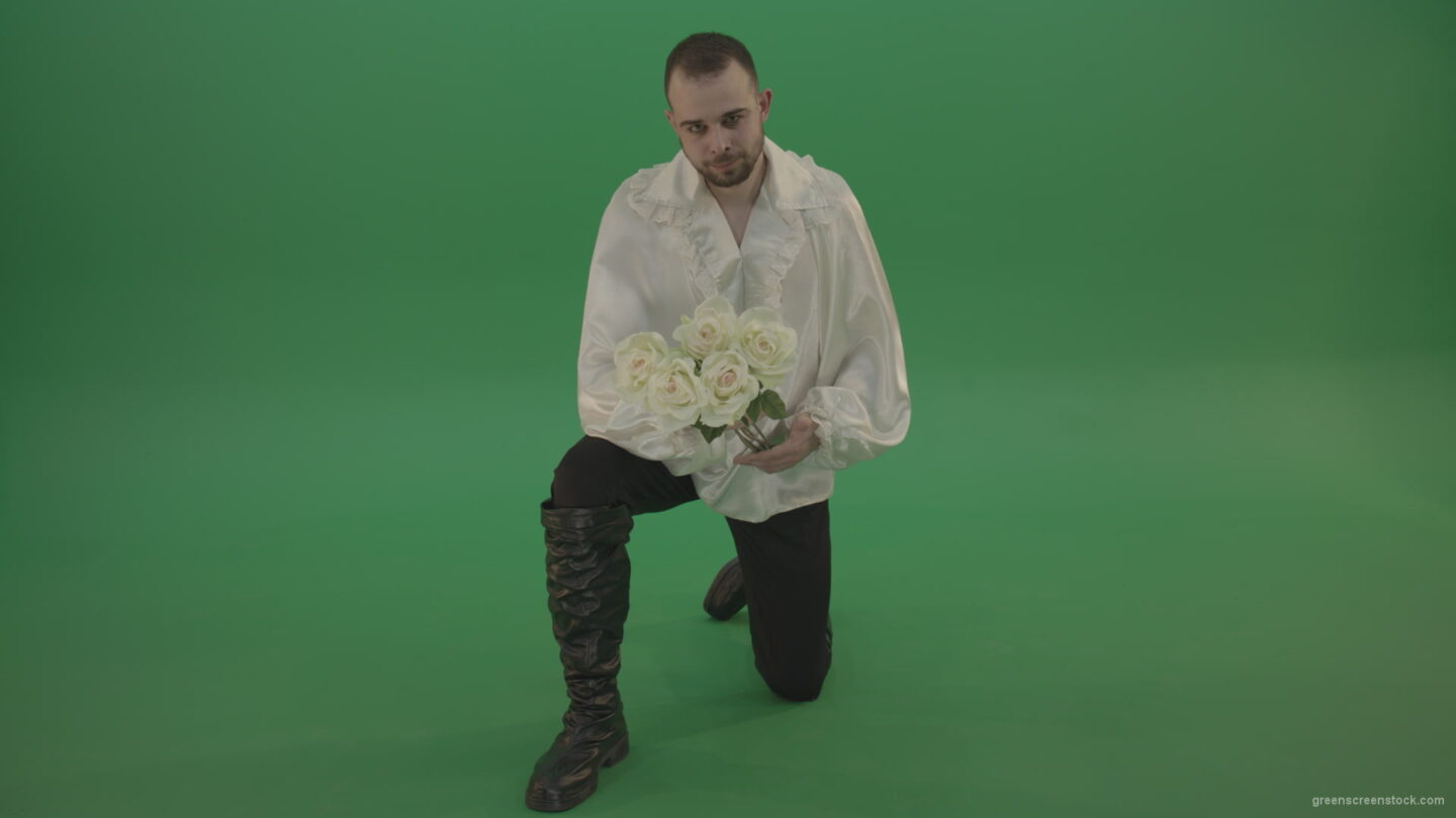 vj video background Medieval-man-gives-white-flowers-standing-on-one-knee-isolated-in-green-screen-studio_003
