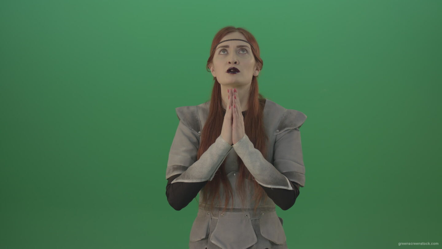 vj video background Red-hair-girl-praying-god-in-medieval-warrior-costume-in-green-screen-studio_003