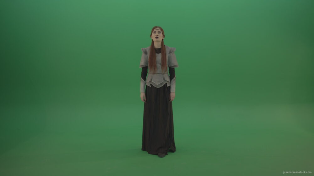 vj video background Redheaded-girl-in-full-height-in-medieval-warrior-clothing-asks-for-help-from-the-gods-on-green-screen_003