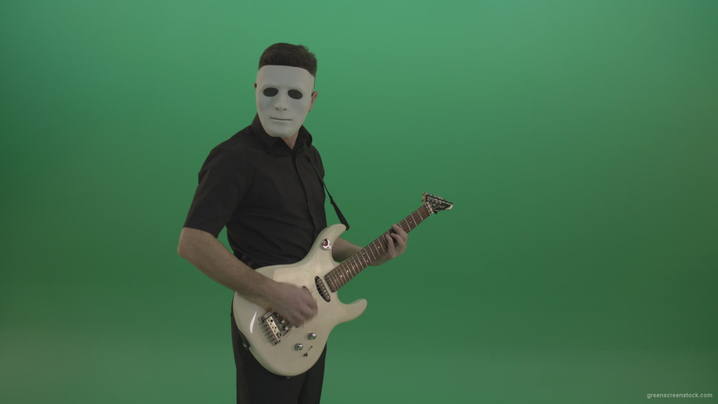 vj video background Rock-man-in-white-mask-and-black-wear-playing-guitar-isolated-on-green-screen-in-side-view_003